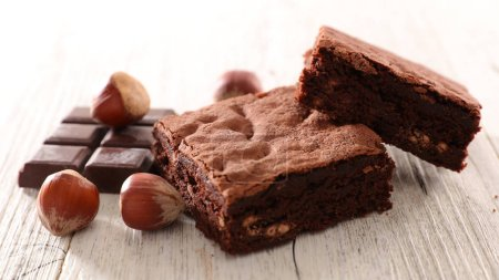Photo for Close up view of food composition with chocolate brownie portion - Royalty Free Image