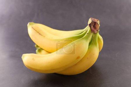 banana bunch on slate slab background
