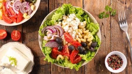 Photo for Vegetable salad with pasta, olive, tomato, onion and feta - Royalty Free Image