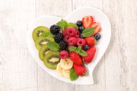 Photo for Heart shape plate with fresh fruits - Royalty Free Image