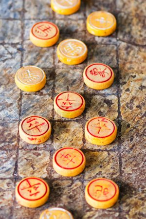 Photo for Tables and game pieces for XiangQi Boardgame, also known as Chinese Chess, Vietnam. - Royalty Free Image