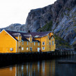 Nusfjord harbor with colorful red fishing houses a...