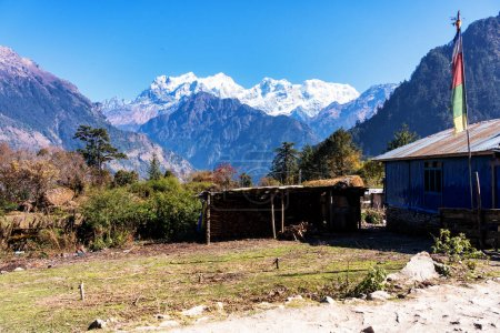 Photo for View of a small town or a settlement on a popular tourist track - Annapurna Circuit Trail in Himalayas, Nepal. Some of the buildings serve for tourist as hotels, lodges and restaurants. - Royalty Free Image