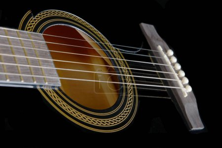 Photo for The bridge,Saddle and sound Hole On a Beautiful Acoustic Guitar - Royalty Free Image