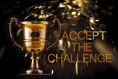 trophy in front of blackboard with text accept the challenge