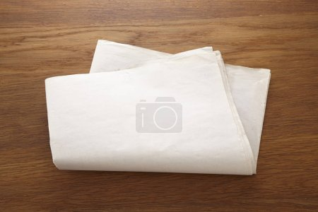 blank paper scroll on wooden table