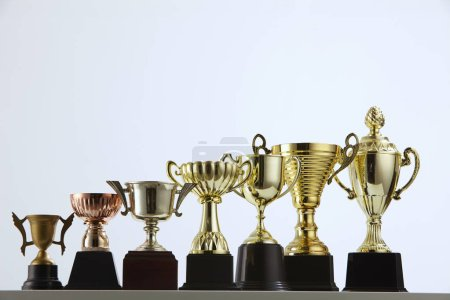 close up of trophies arranged in row
