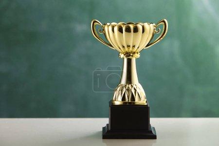 trophy in front of blackboard
