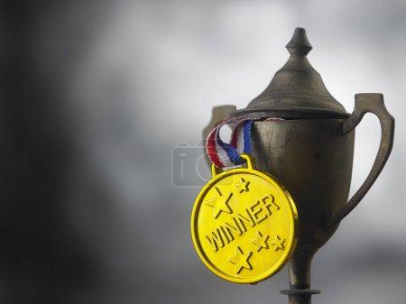 close up of vintage trophy with golden medal