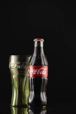 Kuala Lumpur, Malaysia - 6 June, 2017: Coca Cola on black background