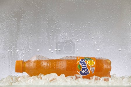 Kuala Lumpur, Malaysia March - 14, 2017: Can of Coca Cola company soft drink Fanta group on ice. Fanta is a global brand of fruit-flavored carbonated soft drinks created by The Coca-Cola Company.