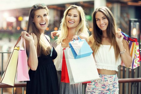 Photo for Picture showing happy girl friends shopping in mall - Royalty Free Image