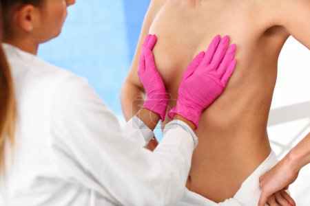 Photo for Picture of female doctor examining breast - Royalty Free Image