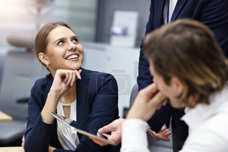 Photo for Group of business people sharing ideas in modern office - Royalty Free Image