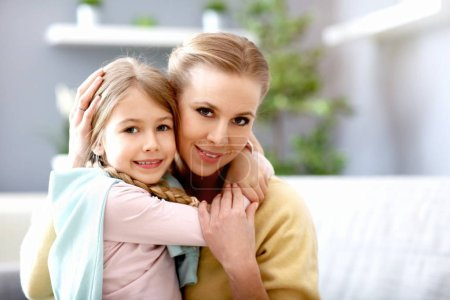 Photo for Picture of beautiful mom and her daughter having fun at home - Royalty Free Image