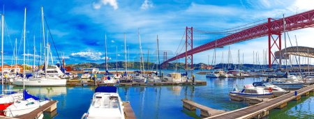 Cityscape of Lisbon and seaport. Entertainment and leisure in Portugal.Boats, sailboats and yachts in the port.Bridge of April 25 in Lisbon.