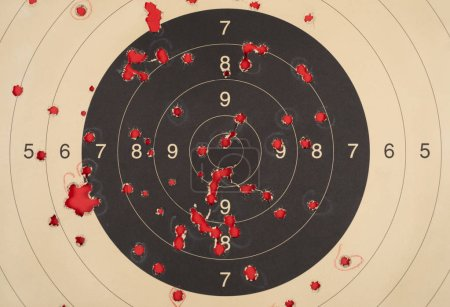 Old brown paper practice target for shooting with bullet holes in it