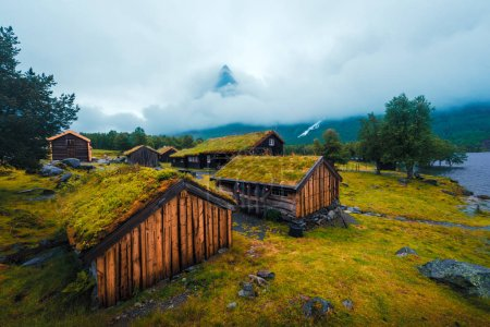 Photo for Typical norwegian old wooden houses with grass roofs in Innerdalen - Norways most beautiful mountain valley, near Innerdalsvatna lake. Norway, Europe. Autumn time - Royalty Free Image
