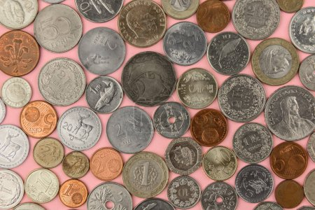 Photo for Different country coins on pink background - Royalty Free Image