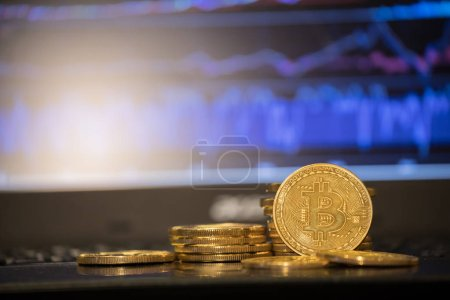 Photo for Golden bitcoin are stacked on a bright background of business graphs close-up. Bitcoin cryptocurrency. - Royalty Free Image