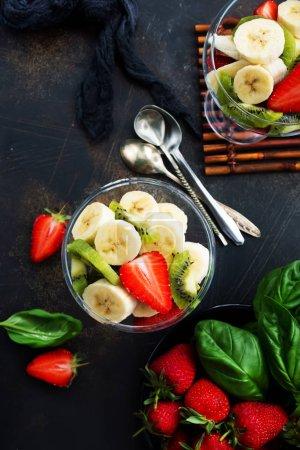 fresh fruit salad with kiwi, banna and strawberries