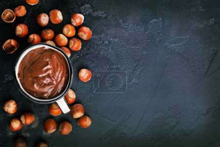 homemade hazelnut spread or hot chocolate in cup with nuts