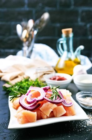 Photo for Sliced raw chicken breast and onion prepared for cooking - Royalty Free Image