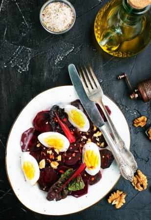 Photo for Boiled beet with eggs on plate, beet salad - Royalty Free Image