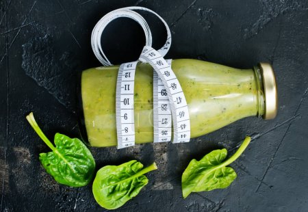 Photo for Smoothie with spinach and kiwi in bottle - Royalty Free Image