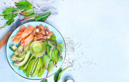 Photo for Healthy food antioxidant products: fish and avocado, nuts and fish oil - Royalty Free Image