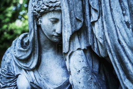 Statue of woman on tomb as a symbol of depression ...