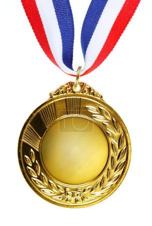 Closeup of golden medal on plain background