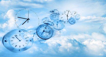 Clocks in sky. Time flies