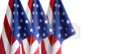 Three American flaga in front of white background