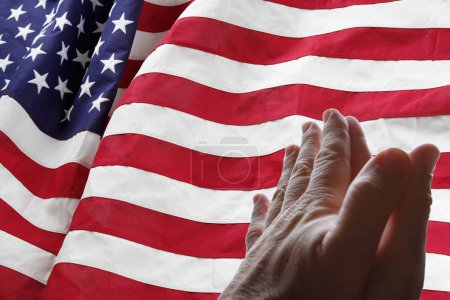 American flag and praying hands