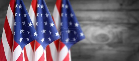 Three American flag and wooden defocused background