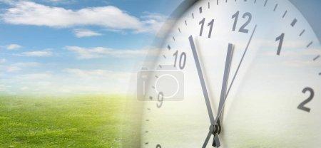 Photo pour Horloge, herbe et ciel. Printemps - image libre de droit