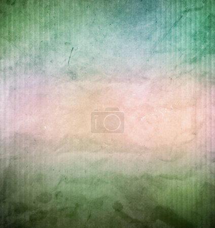 Photo for Close-up of brown and green grunge textured paper background - Royalty Free Image