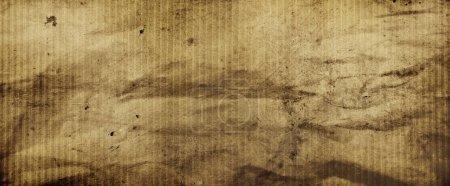 Photo pour Gros plan sur fond de papier texturé brun grunge - image libre de droit