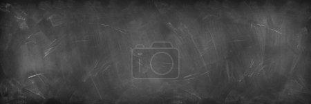 Photo pour Craie frottée sur fond de tableau noir - image libre de droit