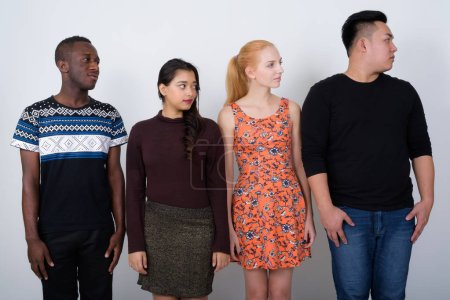 Photo for Studio shot of diverse group of multi ethnic friends looking at the right side together - Royalty Free Image
