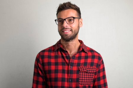 Photo for Studio shot of young handsome bearded hipster man against white background - Royalty Free Image