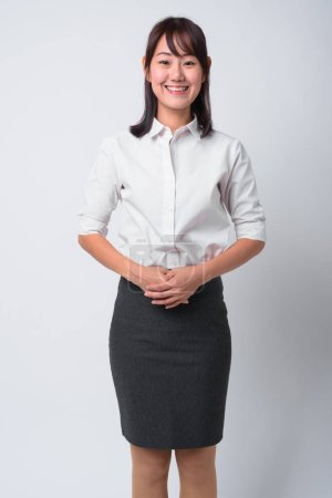 Photo for Studio shot of beautiful Japanese businesswoman against white background - Royalty Free Image