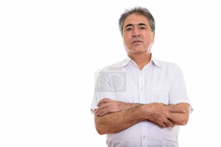 Photo for Studio shot of senior Persian man with arms crossed isolated against white background - Royalty Free Image