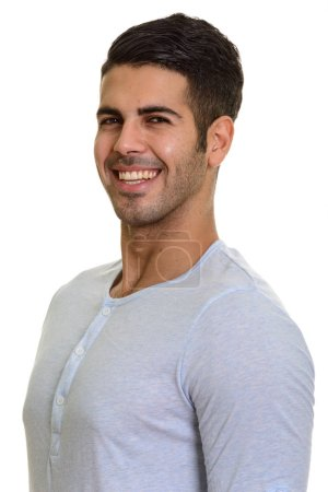 Photo for Young happy Persian man smiling isolated against white background - Royalty Free Image
