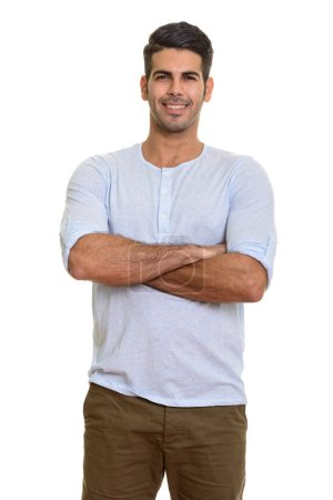 Young happy Persian man smiling with arms crossed