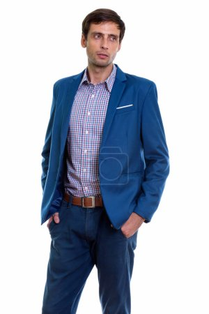 Photo for Studio shot of young handsome businessman thinking while standing and posing - Royalty Free Image