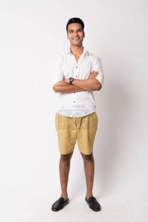 Photo for Studio shot of young handsome Indian man against white background - Royalty Free Image