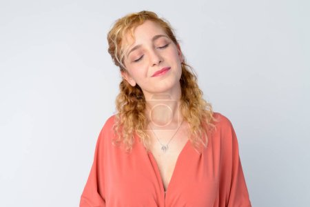 Photo for Studio shot of beautiful multi ethnic woman with curly blond hair against white background - Royalty Free Image