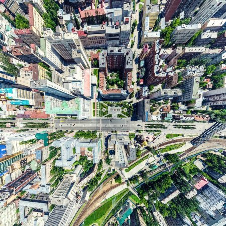 Photo for Aerial city view with crossroads and roads, houses, buildings, parks and parking lots, bridges. Helicopter drone shot. Wide Panoramic image. - Royalty Free Image